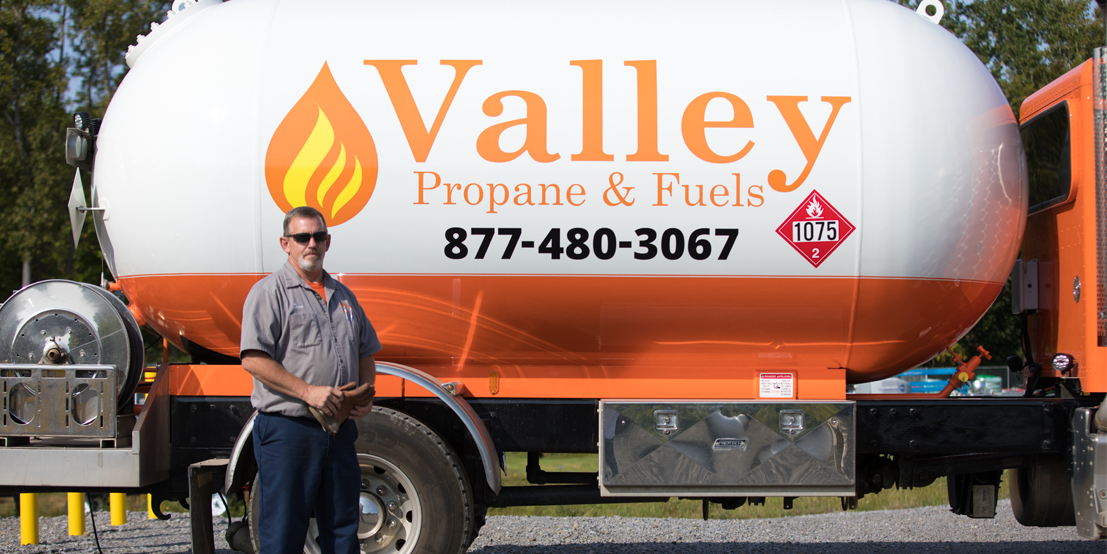 Valley Propane Technician Standing in front of Propane Delivery Truck