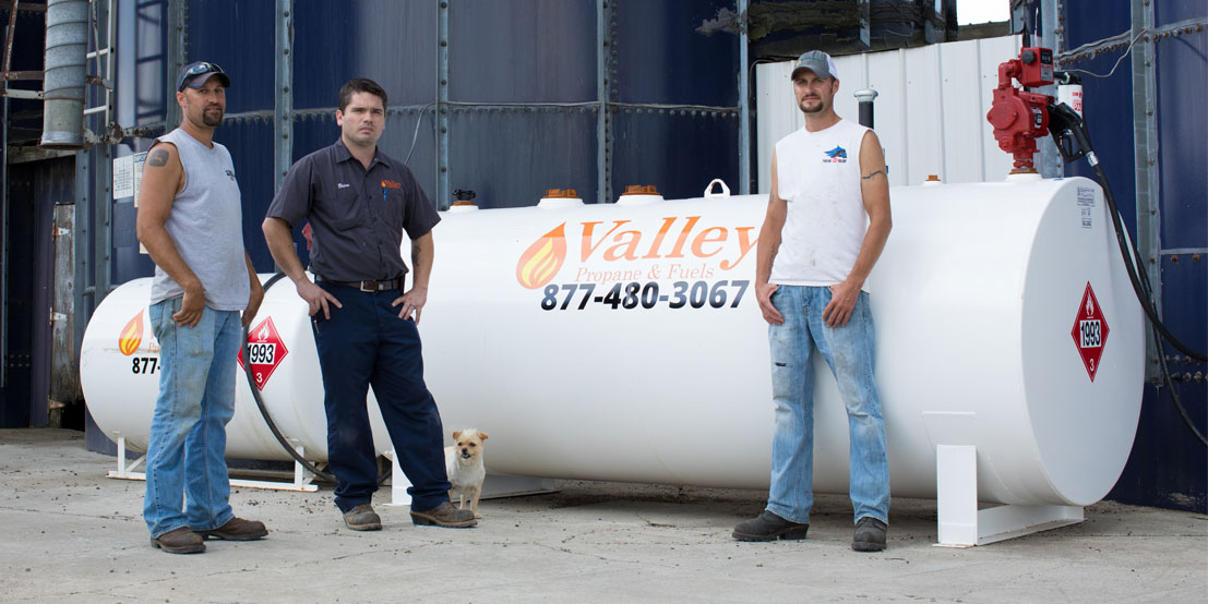 Valley Propane Technicians Standing in front of Commercial Propane Tank